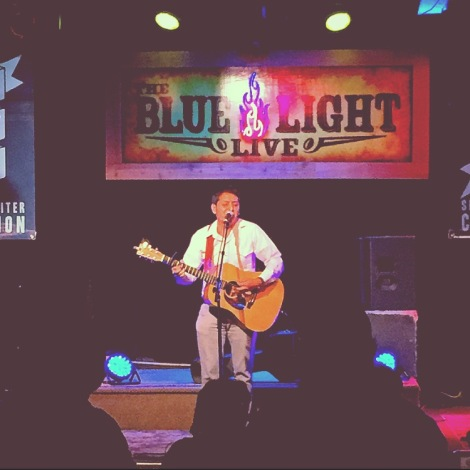 Jerry Serrano performing during The Finals in The Spring Singer-Songwriter Competition. Photo by Aaron Smith.